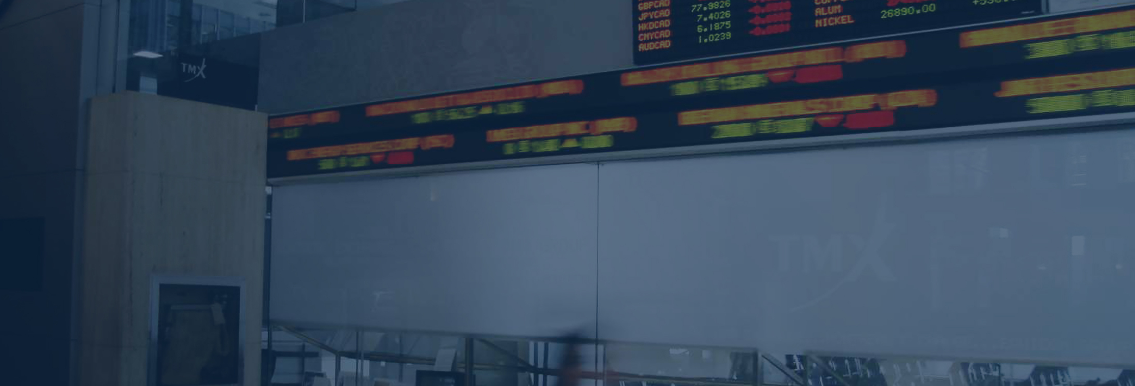 stock screen on wall in banking institution