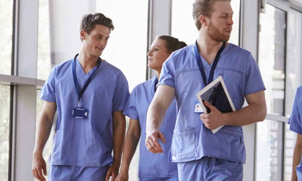 digital signage and employees in healthcare facility