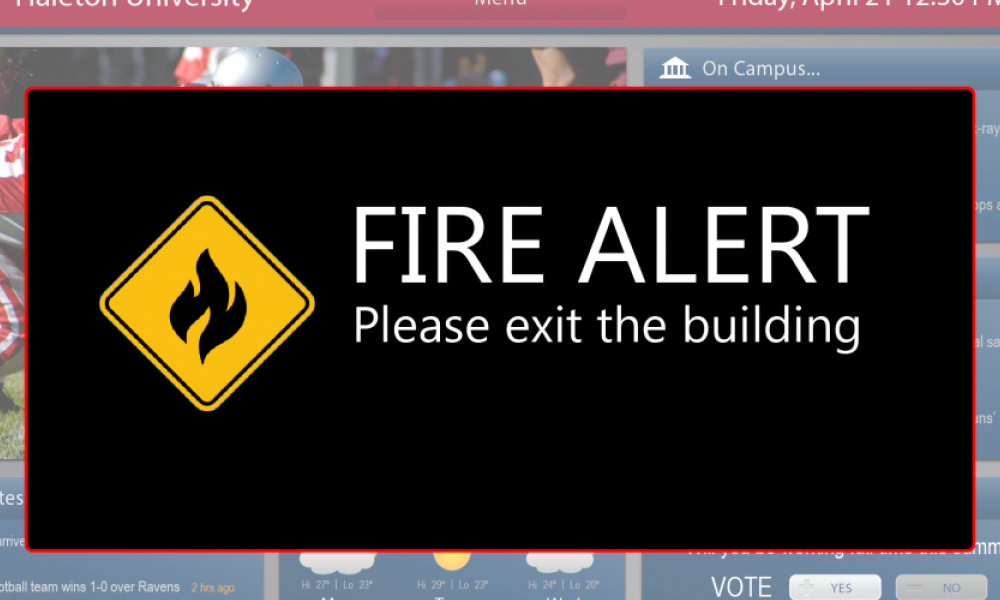 mock education kiosk screen showing fire alert