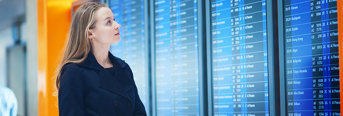 woman looking at arrival and departure screens
