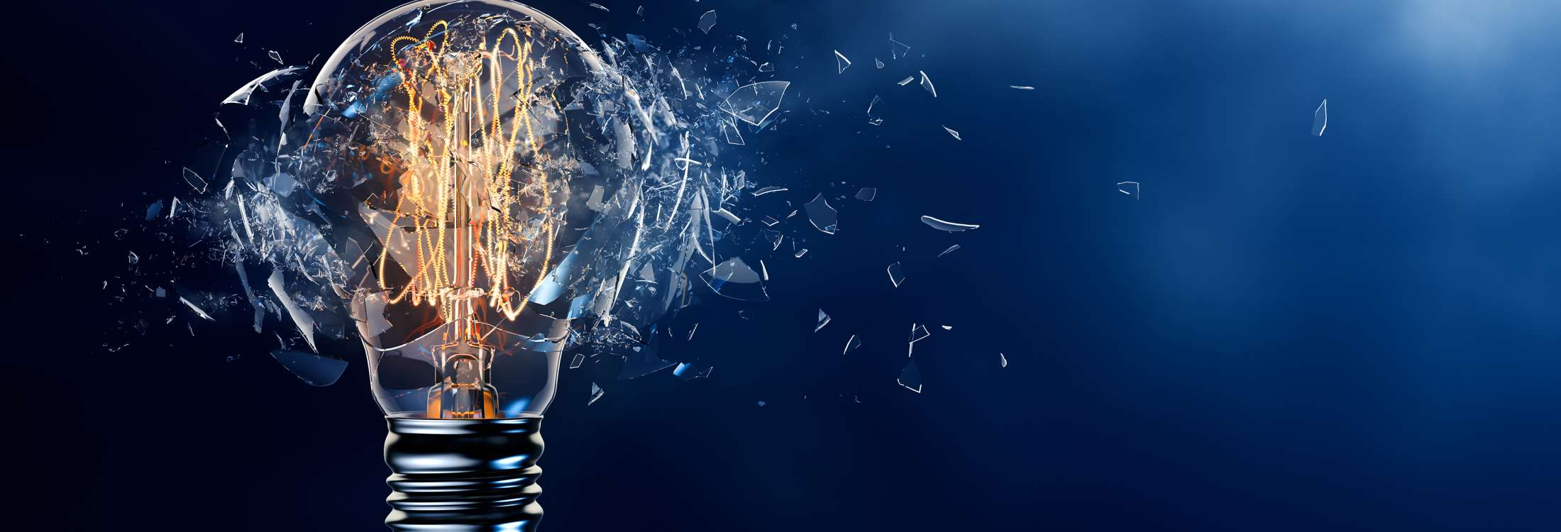 Exploding light bulb with shattered glass on empty blue background