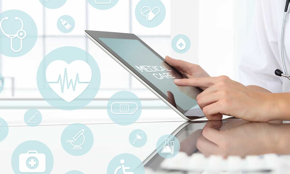 hand on tablet in healthcare setting
