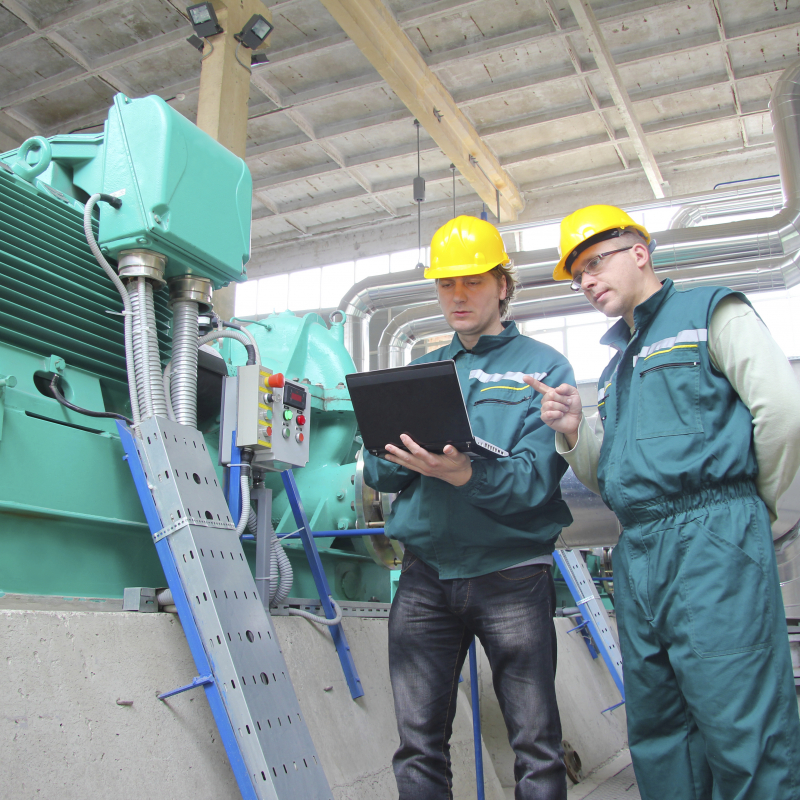 industrial workers with notebook