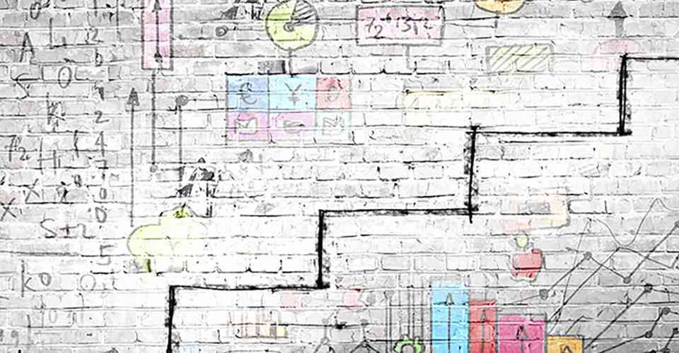 man staring at brick wall with illustration of business concepts