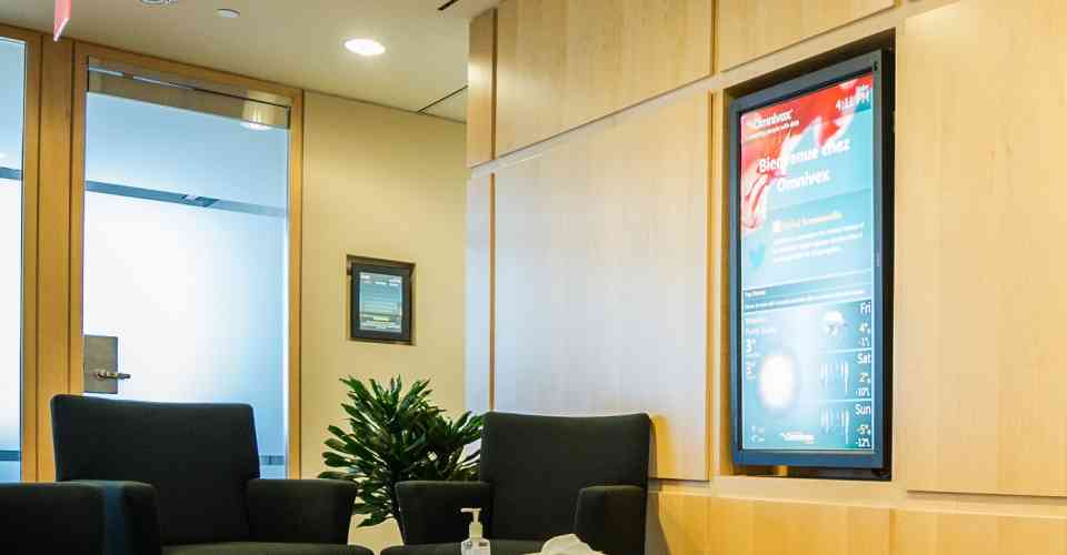 Omnivex lobby with digital screen showing real-time information